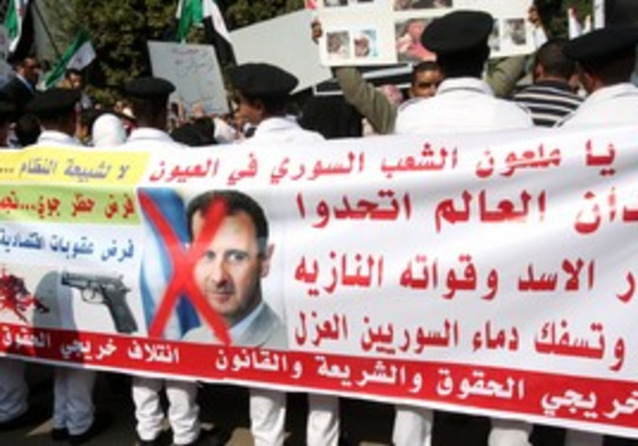 Anti-Assad protesters outside Arab League meeting