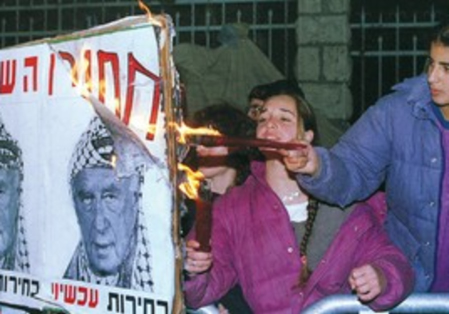 Right-wing activists burn Rabin picture