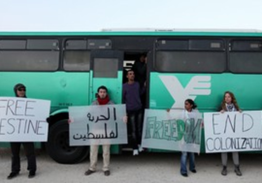 Palestinian activists in front of Egged bus