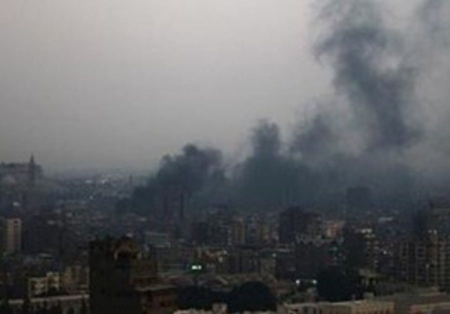 Smoke rises from burning garbage town in Cairo