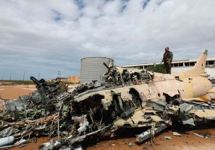 A destroyed aircraft in Sirte, Libya