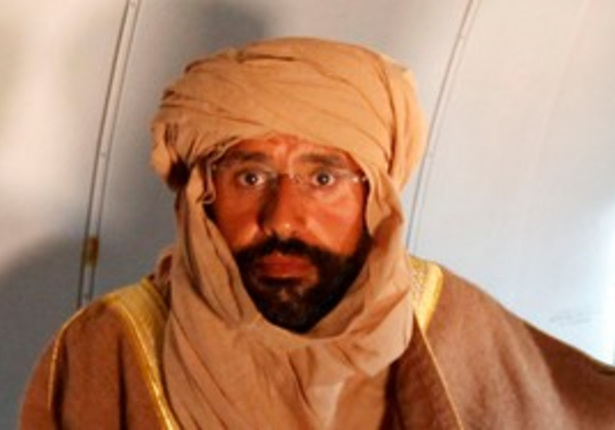 Saif al-Islam Gaddafi is seen sitting in a plane
