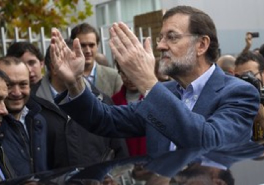 Spains People's Party leader Mariano Rajoy waving