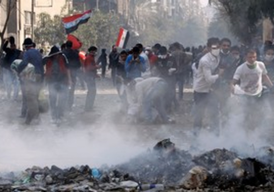 Injured protesters during clashes in Cairo