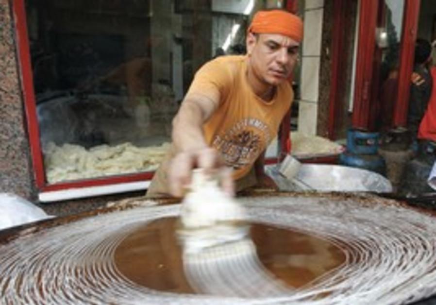 Egyptian man man prepares a traditional dessert