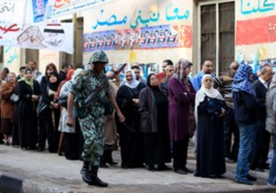 Soldier guards as Egyptians line up to vote
