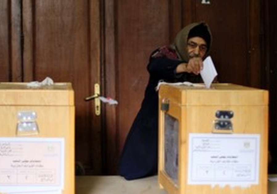 Egyptian man places his vote in the elections