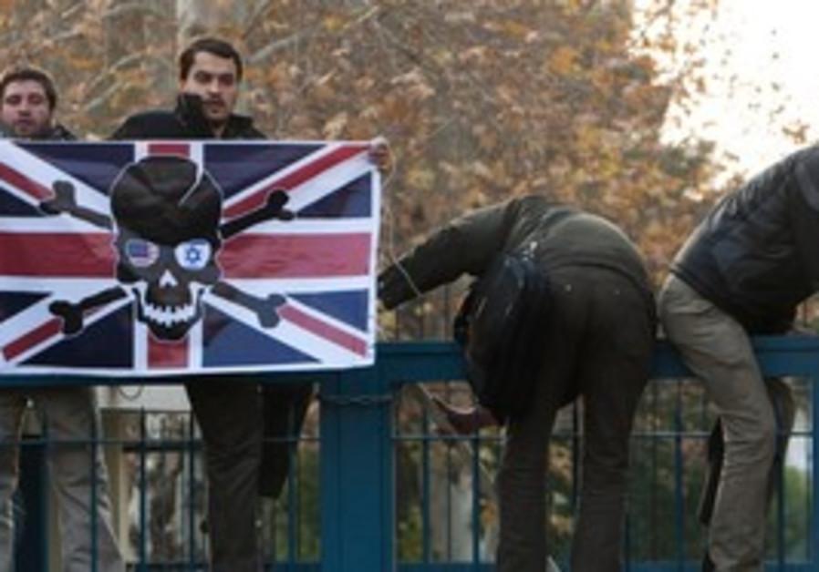 Iranian demonstrators carry a British flag
