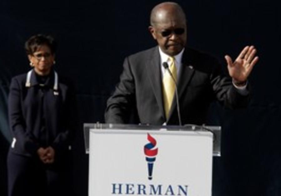 Herman Cain ends presdiential bid  as wife watches