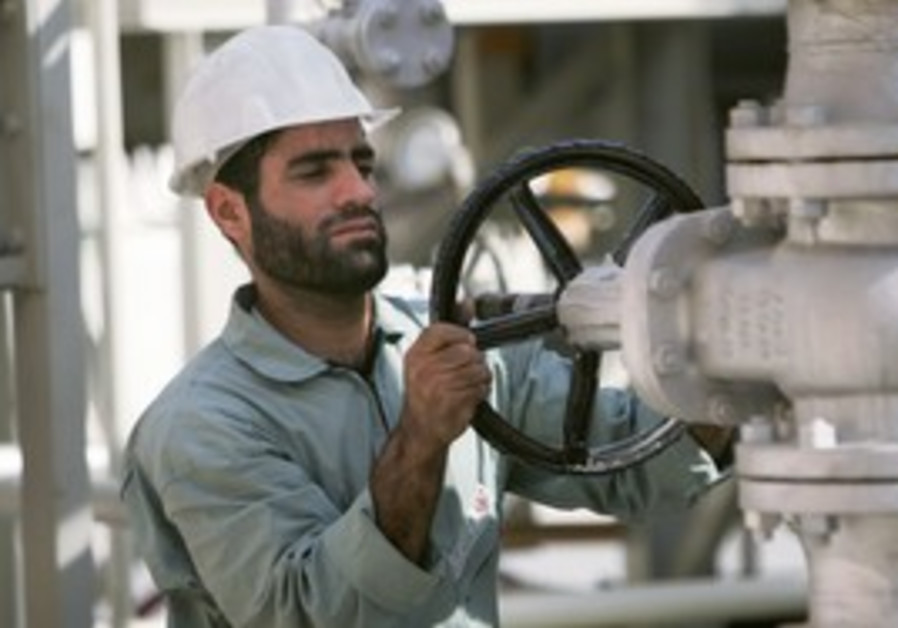 An Iranian oil worker