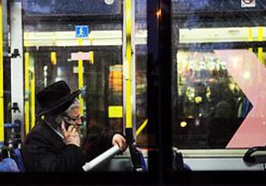 Man riding a bus in Mea She'arim