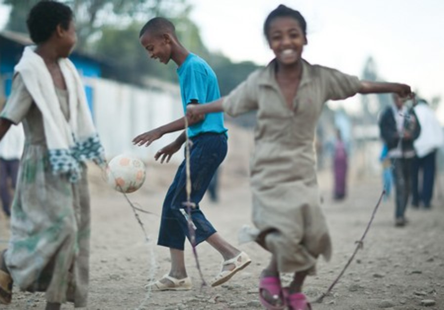 Ethiopian children play in a transit camp