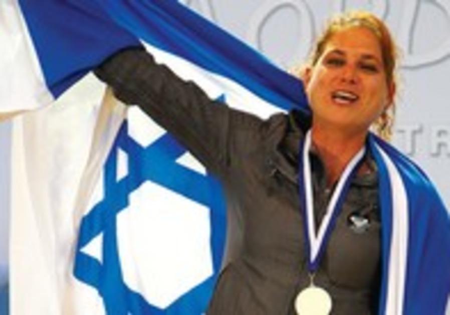 Lee Korzits celebrates winning gold