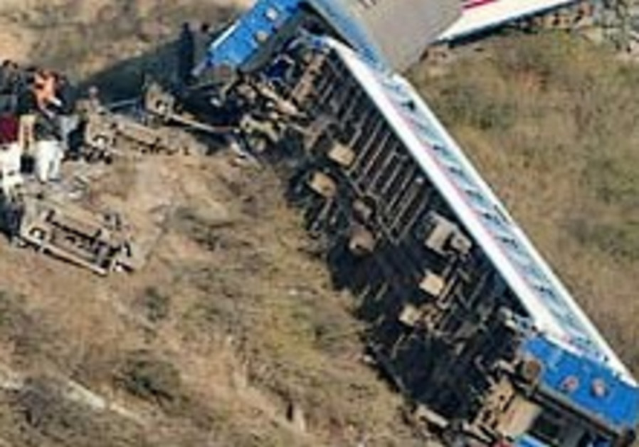 At least 50 people killed as train derails in Pakistan