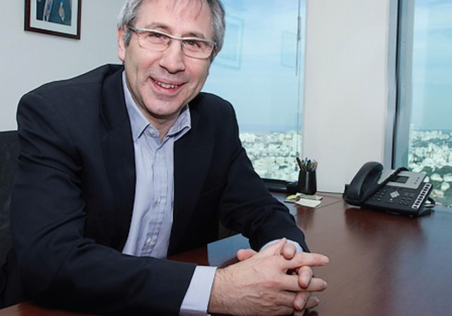 Trevor Asseron in his office in Israel