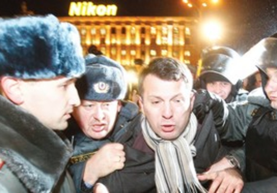 Russian protester being arrested