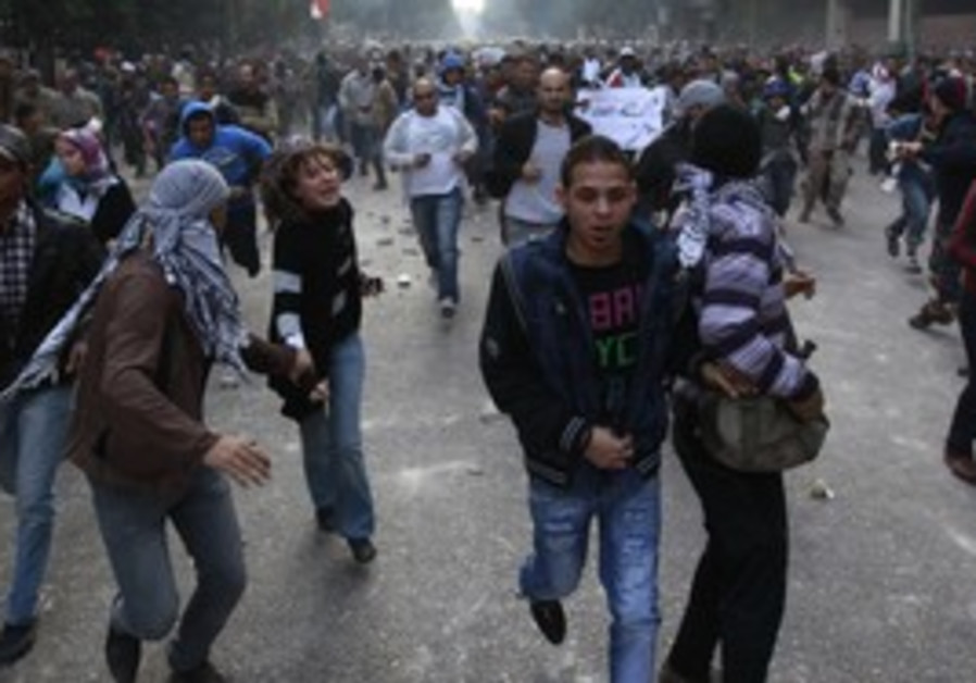 Protesters flee Tahrir Square.