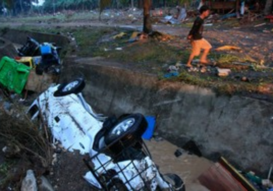 Cars swept away by floods in Philippines typhoon