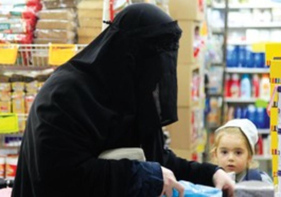 A Jewish woman wears a Burka in Jerusalem.