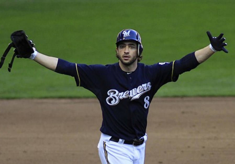 Milwaukee Brewers' Ryan Braun celebrates his 2 RBI