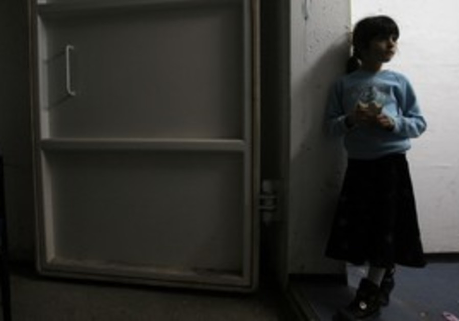 A girl stands inside a bomb shelter in Ashkelon