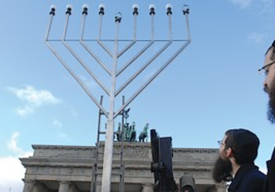 JEWS CELEBRATE the start of Hanukka at the Branden