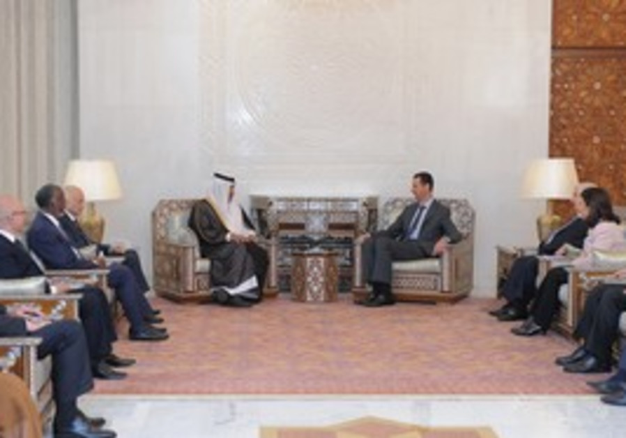 Assad meets with Arab League ministerial team