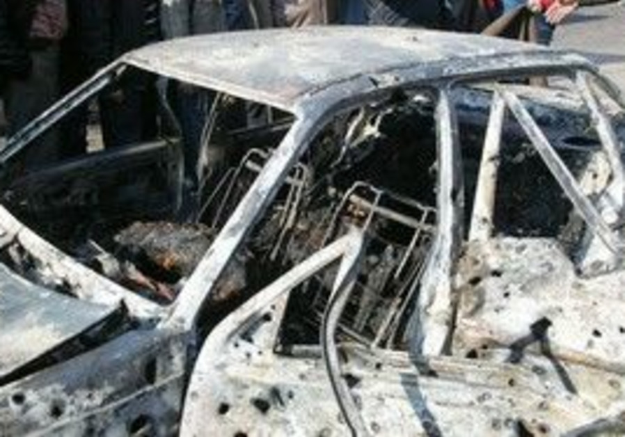 A damage car at the scene of bombings in Damascus