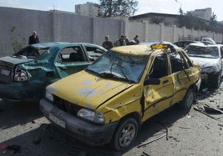Damaged cars in Syria blast.