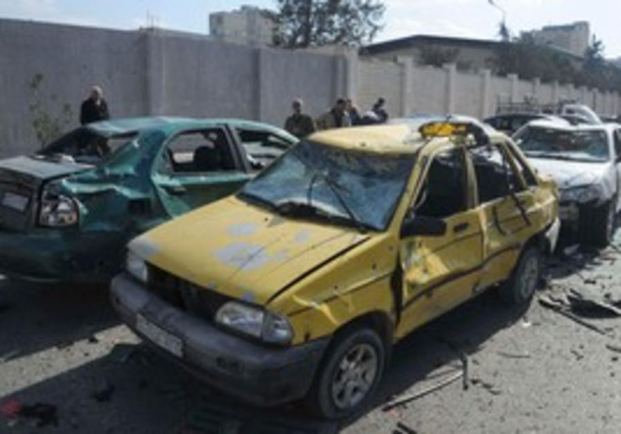 Damaged cars in Syria blast.