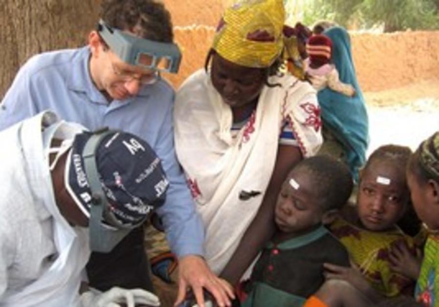 Bruce Gaynor, MD, performs an ocular examination