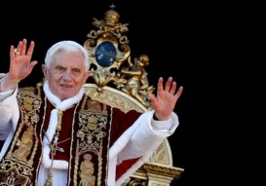 Pope Benedict XVI waves as he gives Urbi et Orbi