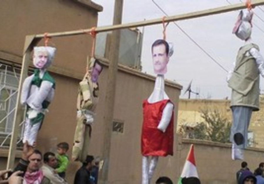 Protesters hang Syrian President Assad in effigy