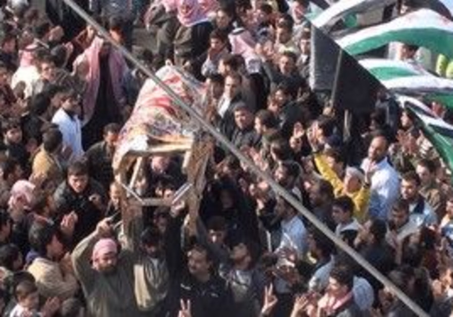 Protesters carry a coffin near Homs, Syria