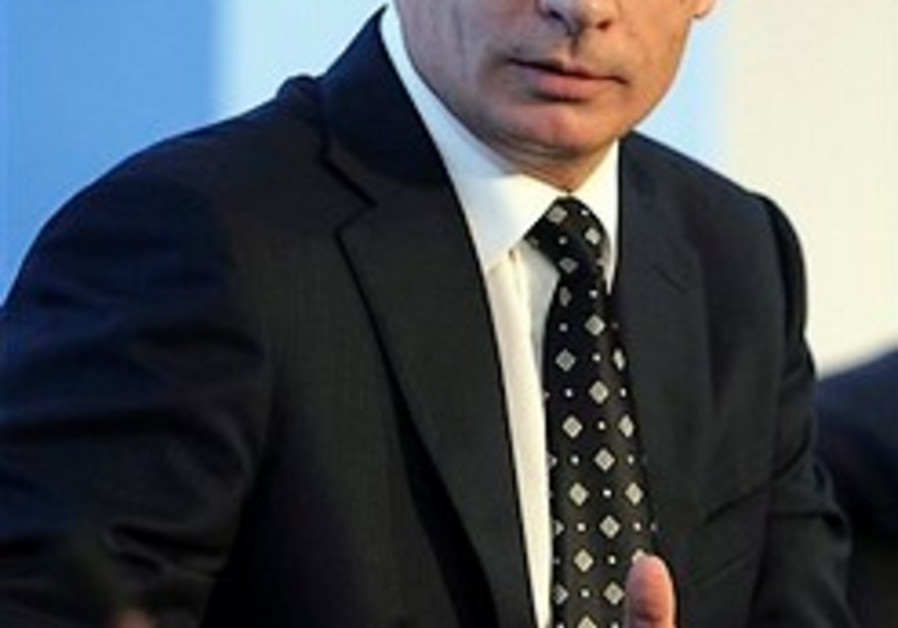 Russia's Prime Minister Vladimir Putin speaks at a