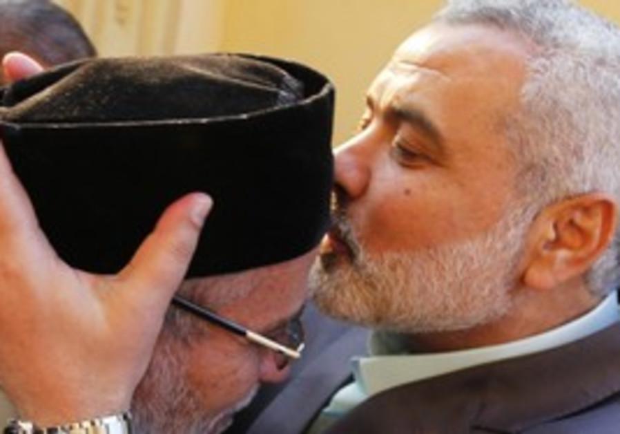 Haniyeh kisses head of Muslim Brotherhood leader