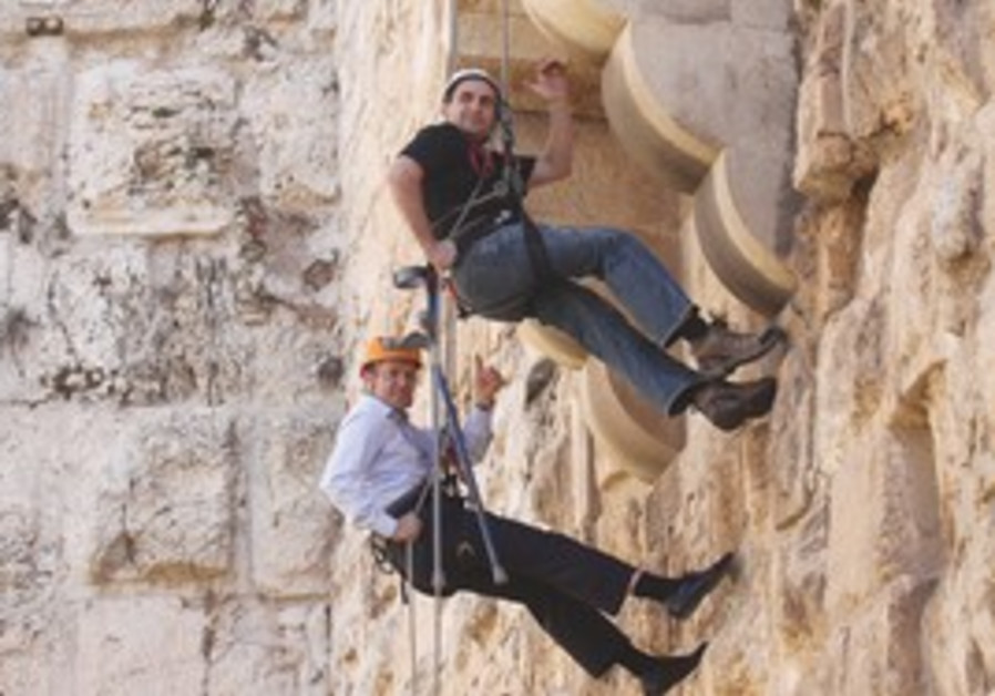Barkat rappels down the wall of the Tower of David