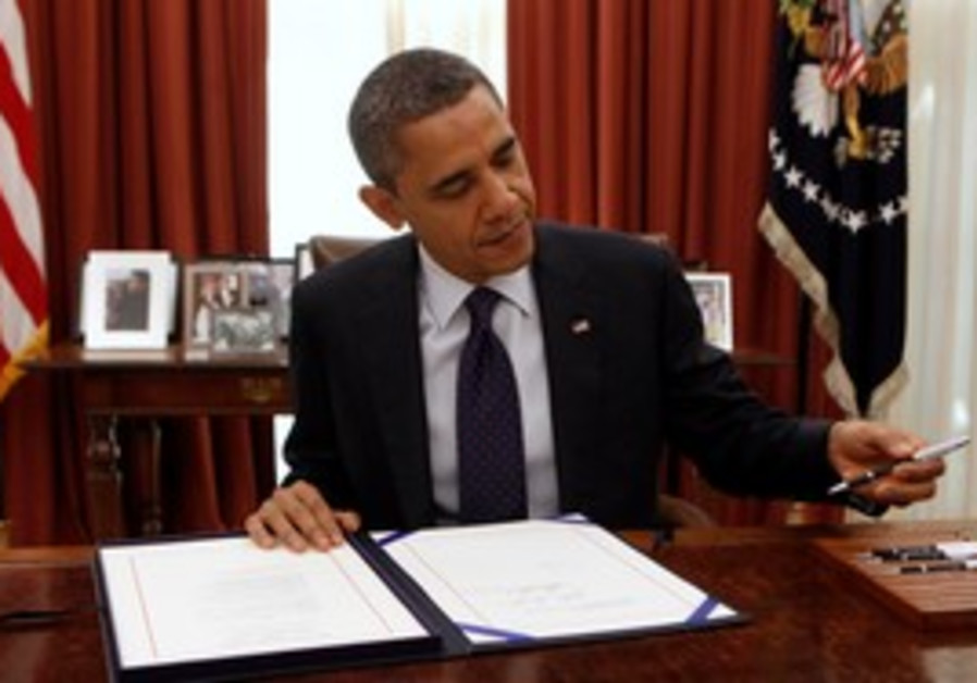 Barack Obama signing a bill [file photo]