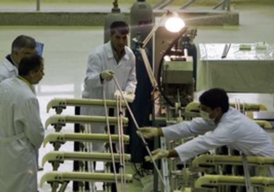 Workers move fuel rod at Isfahan Uranium Facility