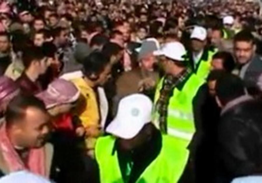 Arab League observers walking through protest