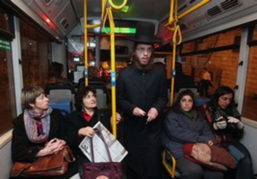 Haredi man passes women sitting in front of bus
