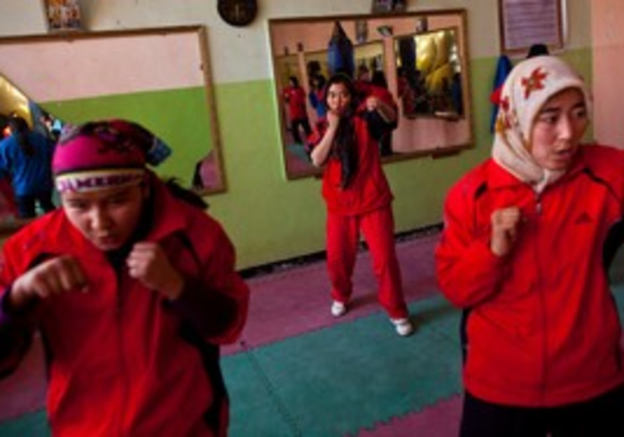 Afghan women practice boxing.