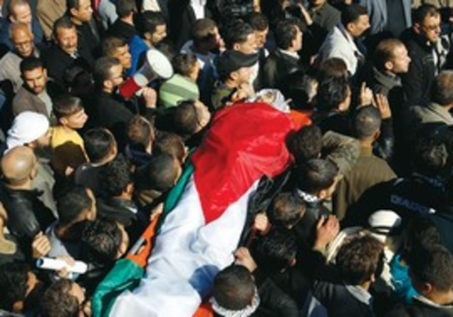 PALESTINIANS CARRY the body of Mustafa Tamimi