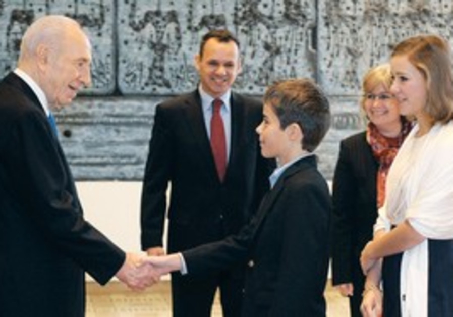 PERES (left) meets the family of Dutch Ambassador