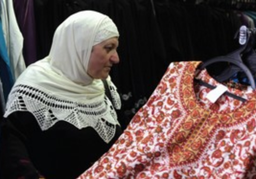 A Palestinian woman shopping [illustrative].