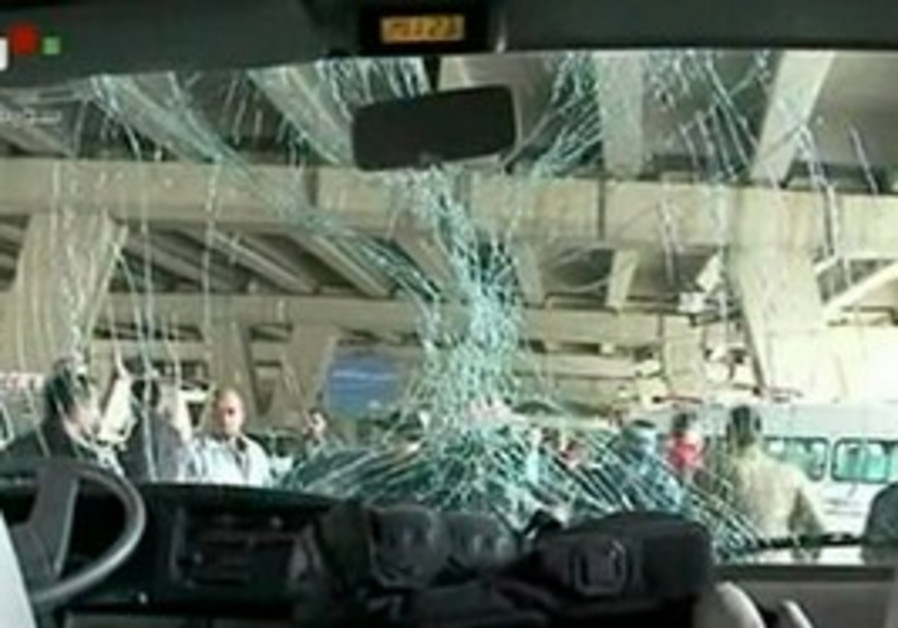 A bus damaged in a Syrian suicide bombing.