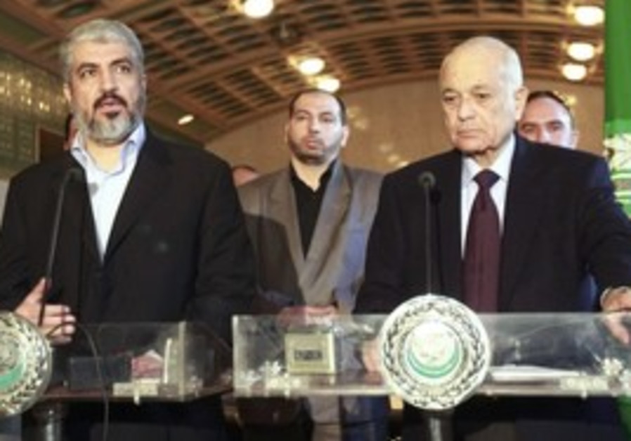 Hamas leader Mashaal (L), Arab League chief Elarab
