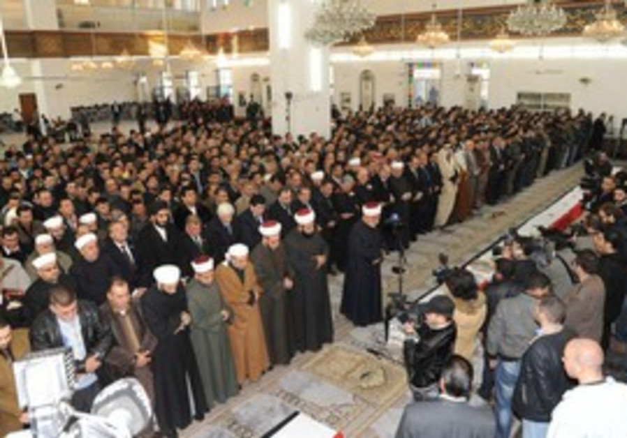 Funeral for 26 killed in Damascus explosion