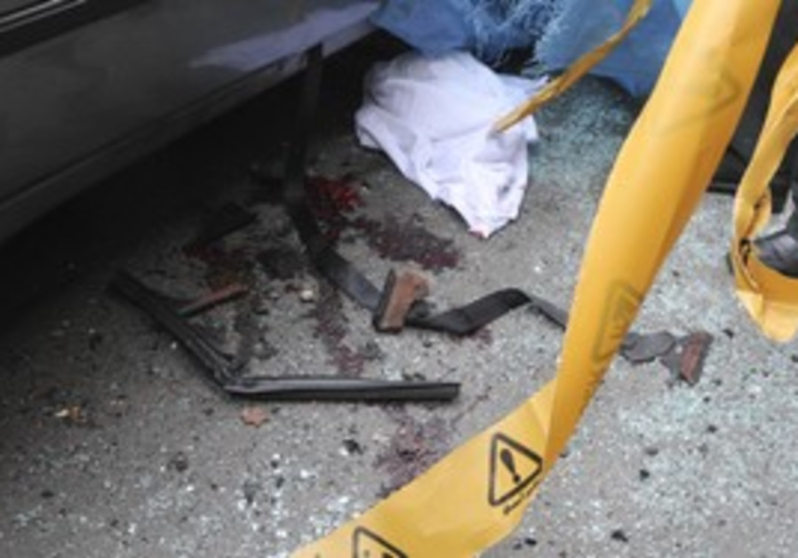 Bloodstains next to Iranian scientist car [file]