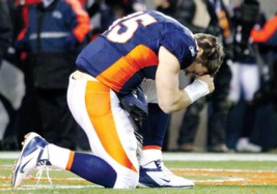 The Denver Broncos' Tim Tebow